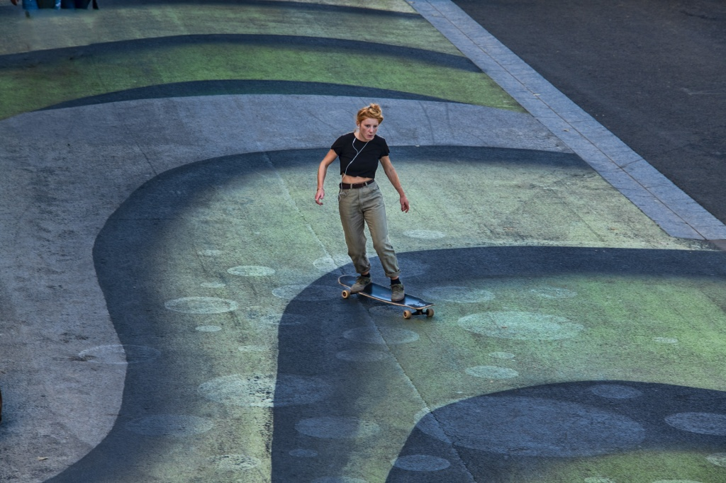 Skateboarder on the bank of the Seine